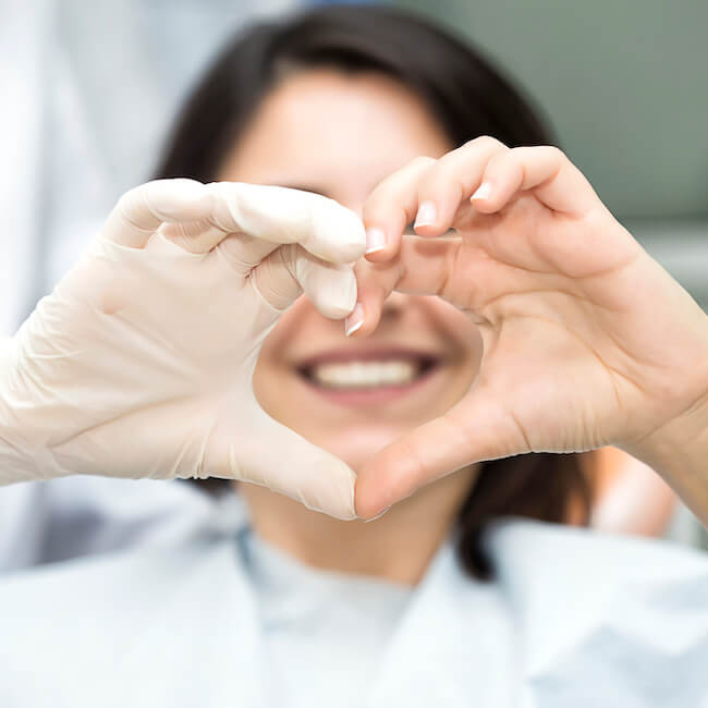 Patient and doctor using their hands to form a heart
