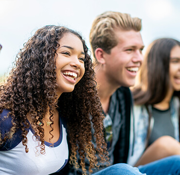 A group of male and female teenagers smiling