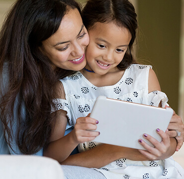 Mother and daughter doing consult on an iPad